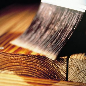 Close up of wood being treated with Seasonite