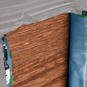 Several layers of paint being removed from a wooden surface