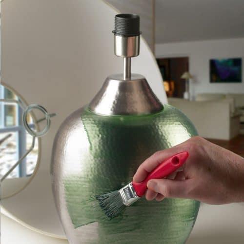 Metallic lamp being painted