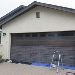 Before and after Polytrol on a garage door