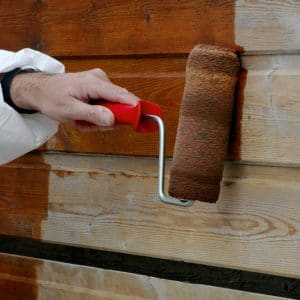 Textrol wood oil being applied to cladding