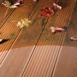 Before and after Compo-Clean being used on a deck