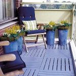 Purple deck with exterior furniture