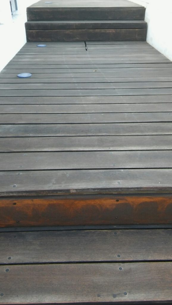 Poolside decking before restoration