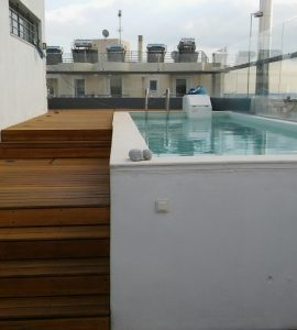Rooftop poolside deck finished with Owatrol