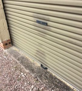 Garage door before application of Polytrol