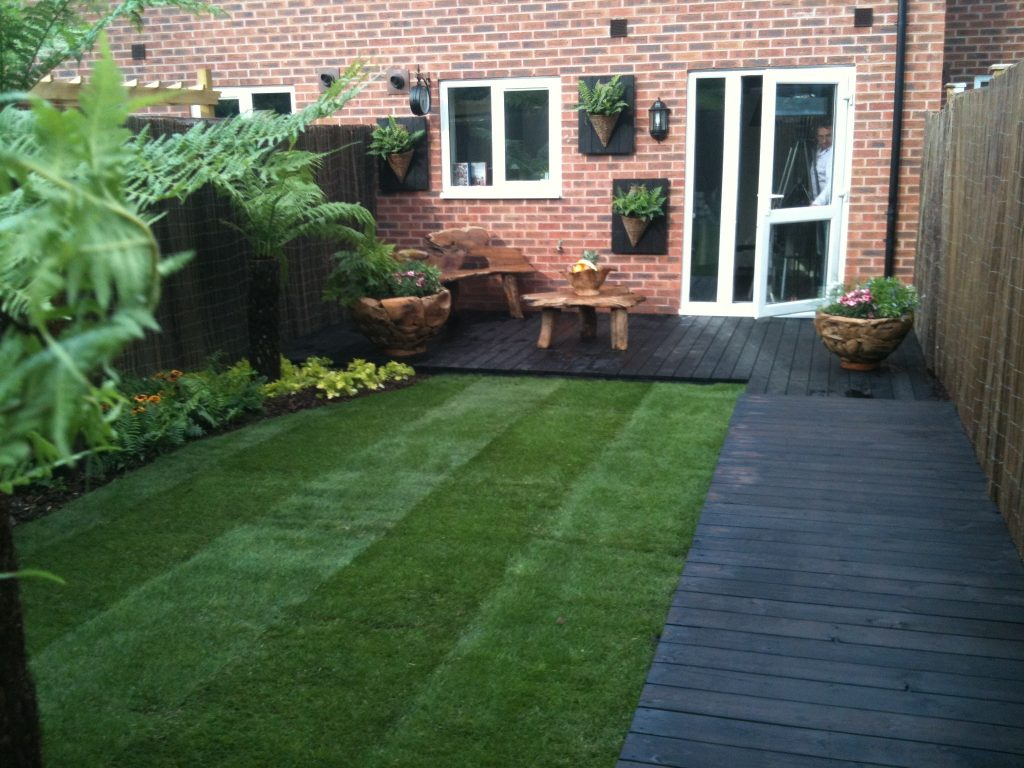 Charred timber decking in a garden
