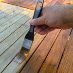 Deks Olje D1 being applied to garden table - ©Adfields