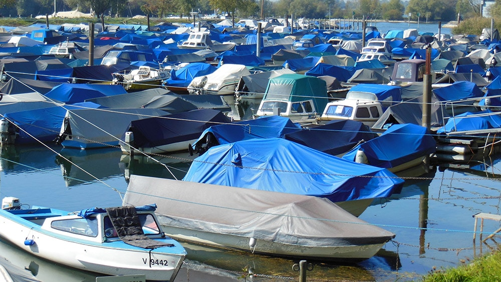 Moored boats with protective covers