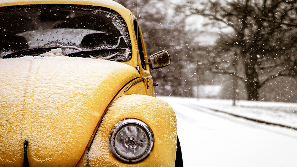 yellow car in the snow