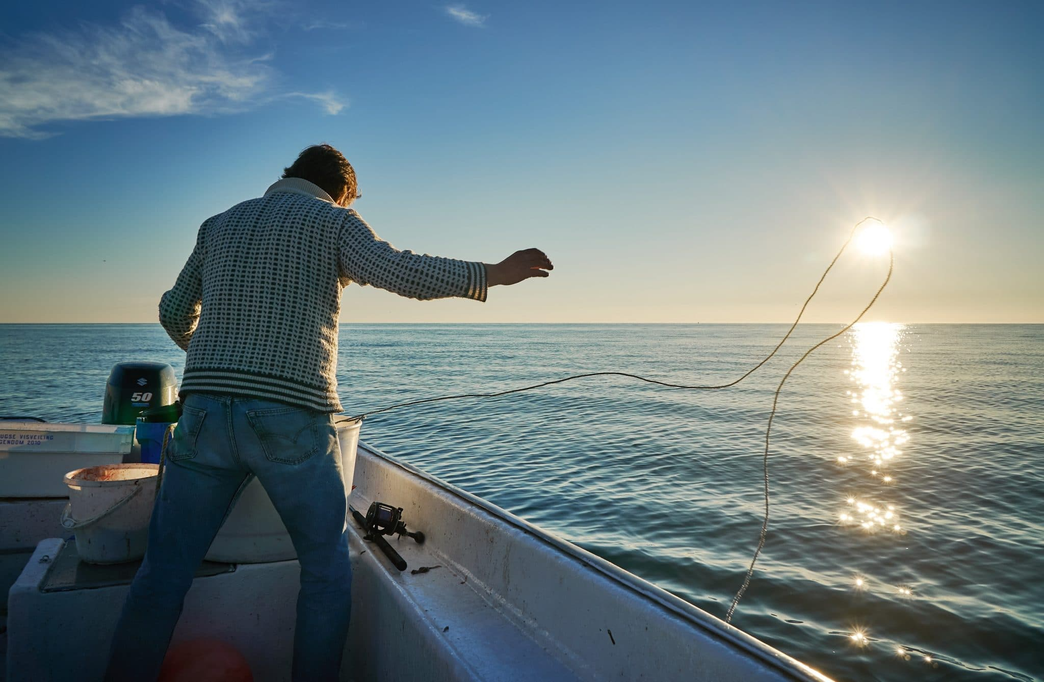 Man casting a line on a fishing boat