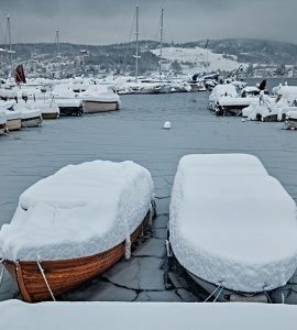 boats in the snow and frozen water