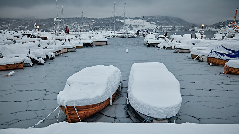 Sailboats covered in snow