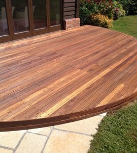 circular hardwood deck finished with Textrol