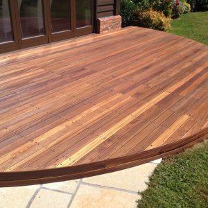 circular hardwood deck finished with Textrol