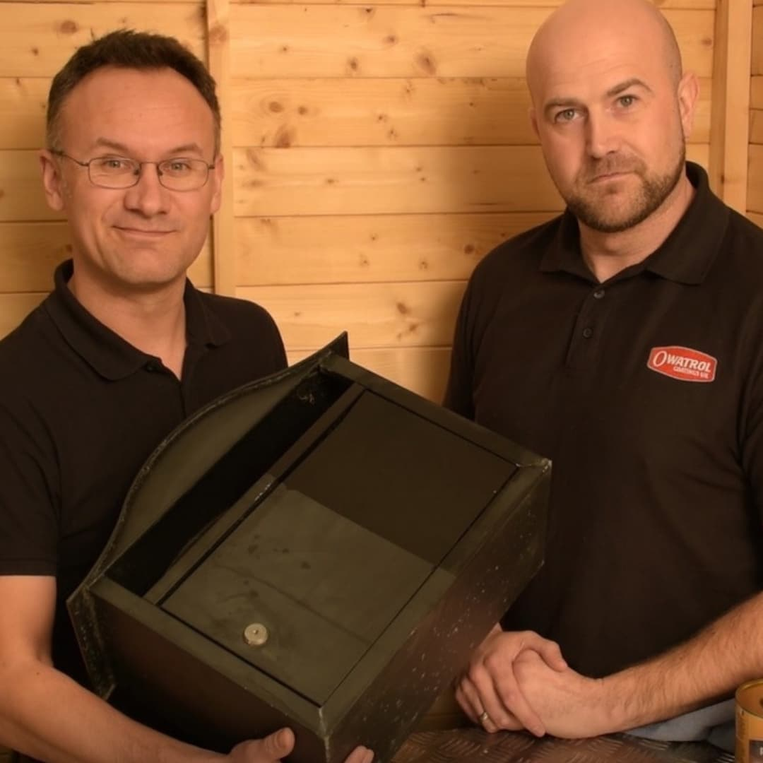 Two men with a mail box that has had Polytrol used on it