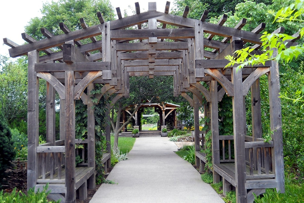 Pergola with benches built into it