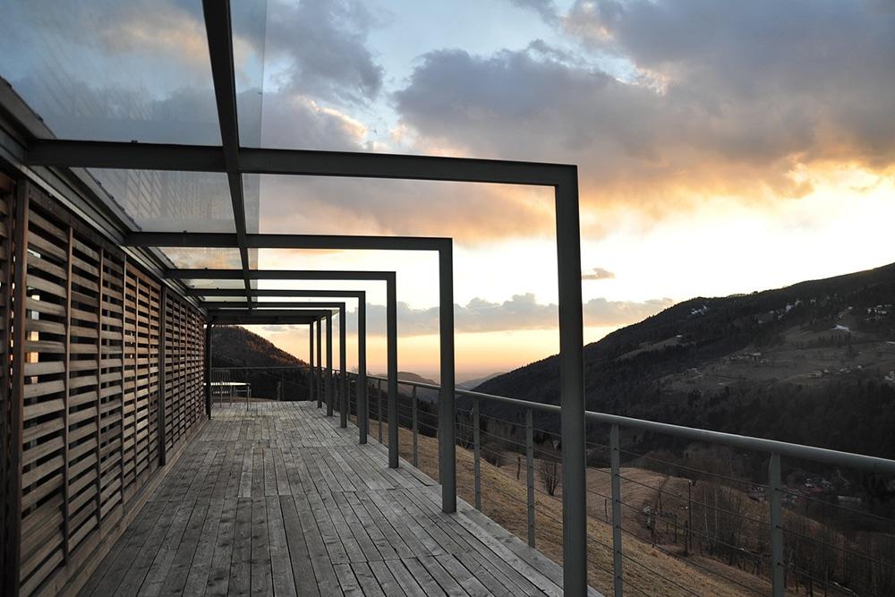 A contemporary pergola over a deck