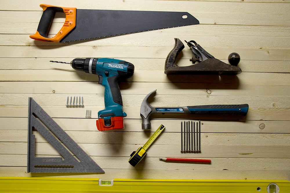 Various tools on a wood floor