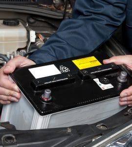 Man replacing a car battery