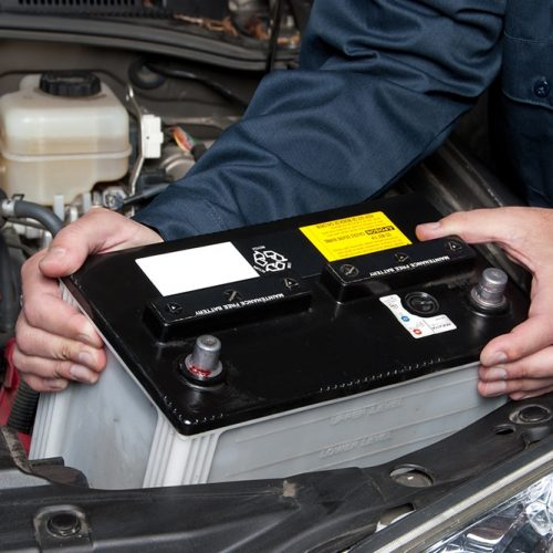 Man replacing a car battery