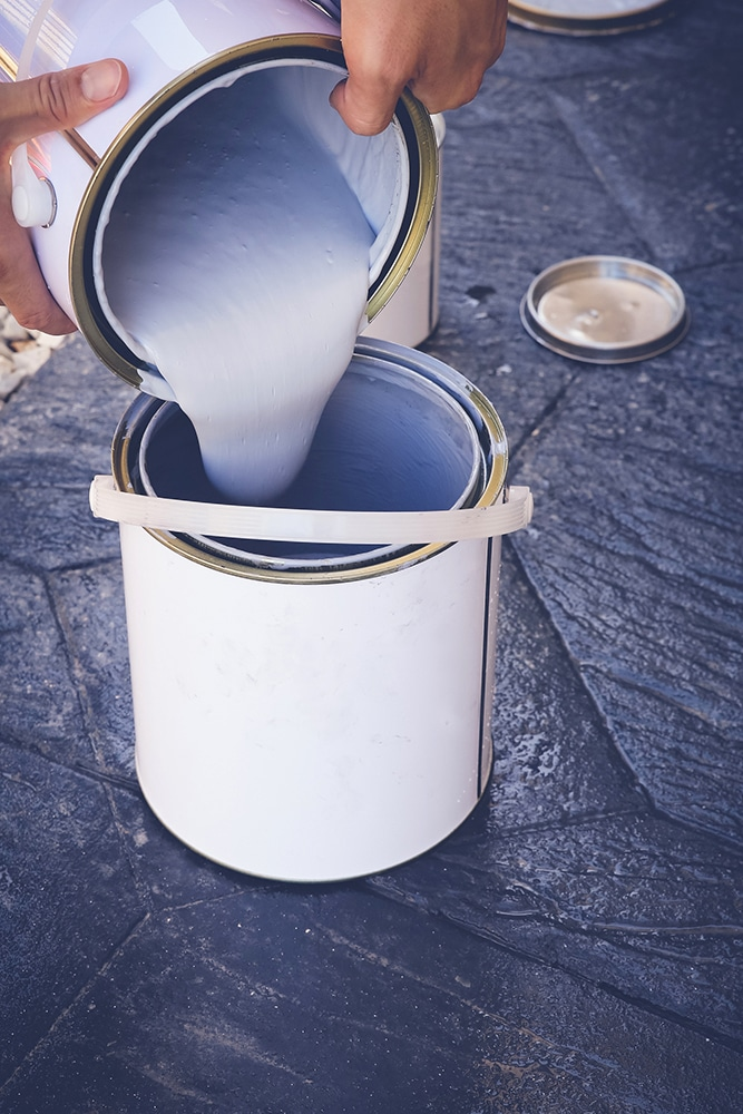 Paint being decanted into another bucket