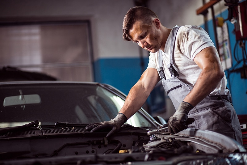 Man working on a car's engine