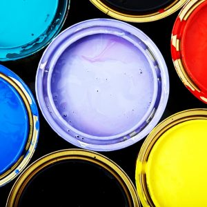 multiple coloured tins of paint
