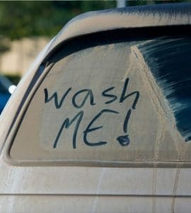 wash me written into car dirt