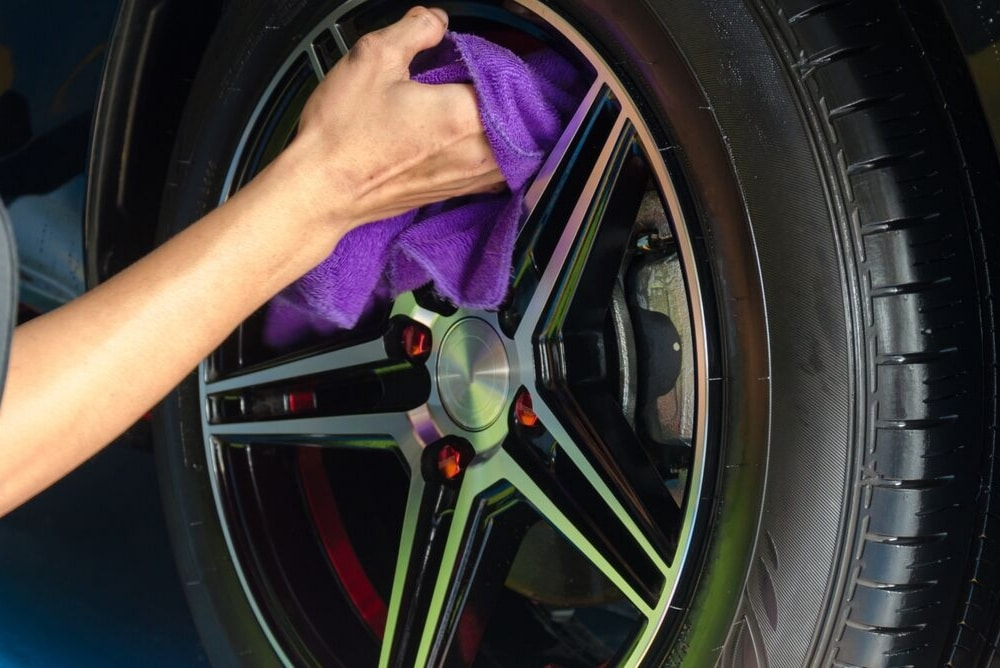 wheel being cleaned with a cloth
