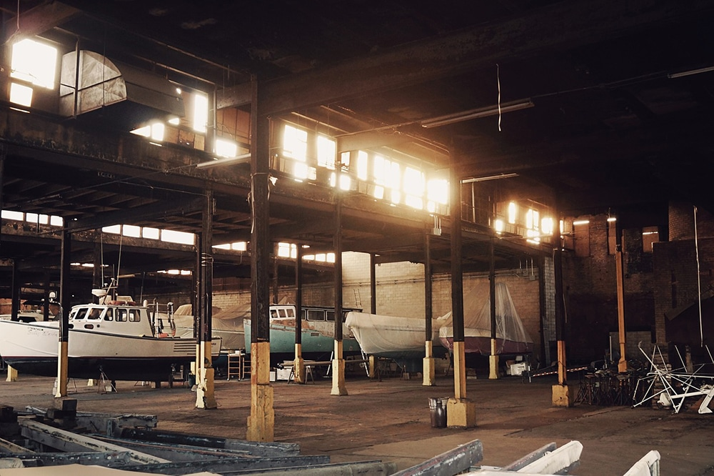 Boats stored inside a warehouse