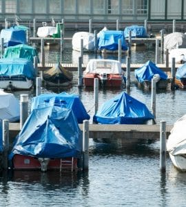 Boats covered and stored in water