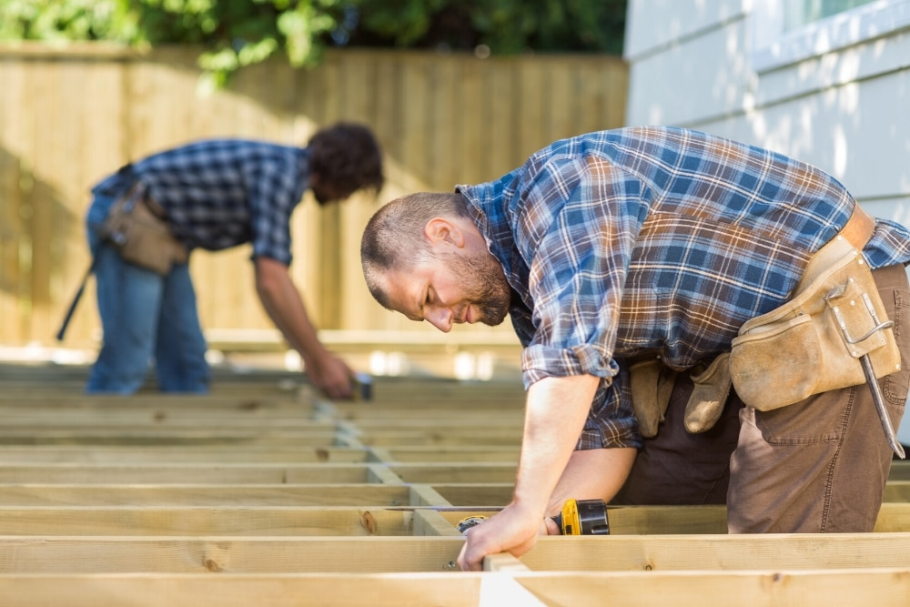 Men building a deck