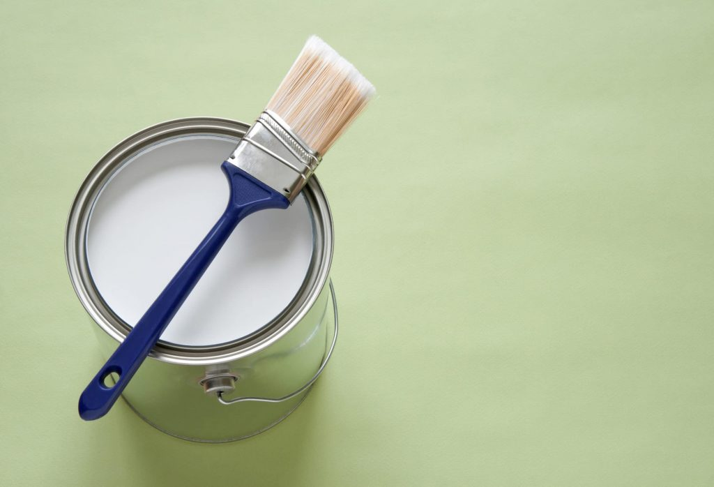 Paint brush and tin of paint
