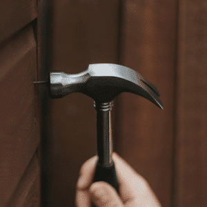 Hammer being used to drive in a nail