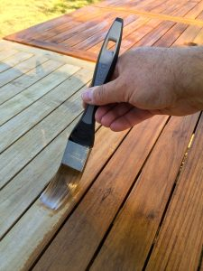 Deks Olje D1 being applied to an outdoor table