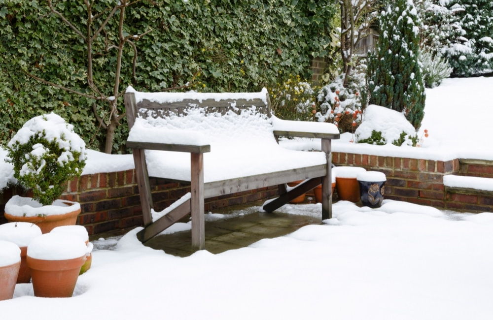 Outdoor furniture covered in snow